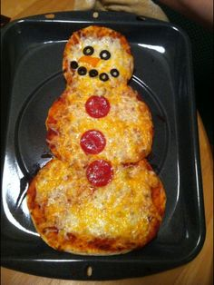 Use your creativity to decorate the snowman. All types of vegetables, olives or pepperoni can be used to make the snowman's face, scarf and buttons. Bake on lowest oven rack for 12 to 15 minutes, until cheese is bubbly and crust is browned.