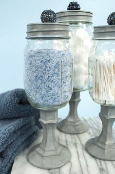 Mason jars, candle stick holders, spray paint and cool little knobs. Apothecary Mason jars, candle stick holders, spray paint and cool little knobs. Mason Jar Projects, Mason Jar Crafts, Mason Jar Diy, Mason Jar Bathroom, Bathroom Ideas, Bathroom Storage, Uses For Mason Jars, Bathroom Containers, Bathroom Crafts
