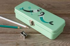 The Danica Studio Sea Spell Pencil Box is perfect for storing pens, pencils and small accessories in one trusty place. Pencil Boxes, Tin Boxes, Landline Phone, Spelling, Pens, Organize, Basket, Studio, Accessories
