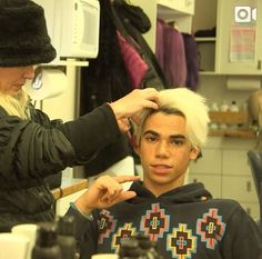 Cameron Boyce as Carlos getting ready to go on set