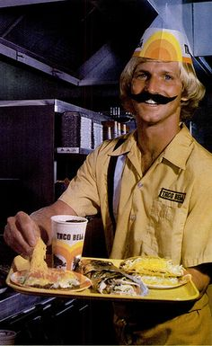 Taco Bell. Yea, that 'stache is real. And I like that he's touching the food with his bare hands...