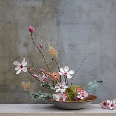 Stunning tulip magnolia branch #ikebana from our floral design team. Link in profile to hear what they had to say about the inspiration, today on the blog. #designbyterrain
