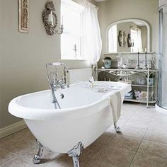 Chic bathroom  Use a decorative freestanding bath as the focal point for creating a relaxing bathroom. Detailed fretwork furniture and candle-holders add a feeling of luxury.