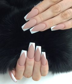 Want to look dangerous without having to? You can have a matte nude base and then paint the sides of the tips in white. This will create an illusion of sharp claws.