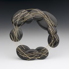 ANDREA WILLIAMS - reclaimed precious metals in conjunction with seemingly ordinary organic materials.