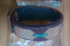 I made this leather cuff with copper hammered copper pieces and a silver butter knife