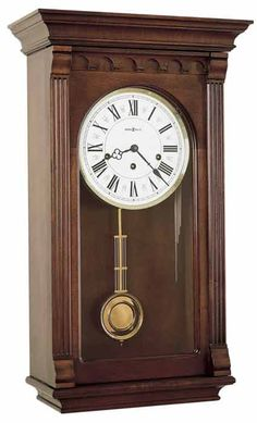 chiming Key-Wound wall clock 613229 Alcott Finished in Windsor Cherry-This traditional wall clock has an impressive pediment features a sculptured cove and enlarged dentil molding. Wall Clock Plans, Desk Plans, Mechanical Wall Clock, Chiming Wall Clocks, Howard Miller Wall Clock, Dentil Moulding, Grey Hardwood, Mantel Clocks, Grandfather Clock
