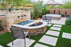 A raised fire pit provides the perfect place for your guest to kick back and relax around each evening to the gentle falls of a simple water wall. Water and fire go well together when combined in such a space, and evening lighting is also easily reflected for nighttime ambiance.