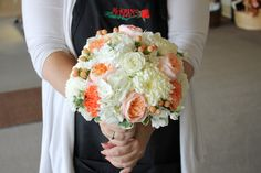 Structured peach and ivory bridal bouquet.