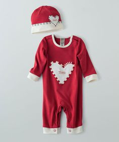 Two of our most popular Christmas baby clothes items in one set! The Candy Cane Heart romper features bright holiday colors, an embroidered fabric heart and lots of secure snaps for quick changes on the go. The Candy Cane snug hat has another big embroidered heart on the band and is made of our softest cotton terry fabric. You can buy them separately in our Candy Cane Lane collection, but this set is the best deal. Available only online at Hallmark Baby.