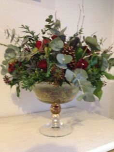 red rose and eucalyptus table arrangement