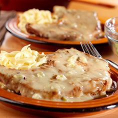 Autumn Pork Chops  ingredients 1 tablespoonvegetable oil 4 bone-in pork chops, 1/2-inch thick (about 2 pounds) 1 10 3/4ouncecanCampbell's® Condensed Cream of Celery Soup (Regular or 98% Fat Free) 1/2cupapple juice or water 2 tablespoonsspicy-brown mustard 1 tablespoonhoney Generous dash ground black pepper Hot cooked medium egg noodles  directions 1.Heat the oil in a 10-inch skillet over medium-high heat. Add the pork and cook until well browned on both sides. 2.Stir the…