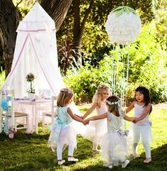 garden party, pretty use of mosquito net and children...