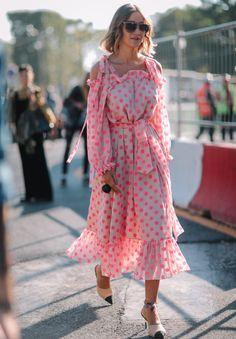 woman wearing a polka dot maxi dress