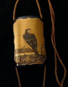 Japanese 'inro' (small, multi-chambered accessory case to be tucked into one's obi (sash) to hold money, smoking items or medicine) with hawk on perch. Lacquer with gold from http://www.japanese-inro.com .