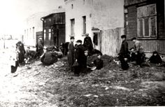 Lodz, Poland, Children in the ghetto digging in search of food. Belongs to collection: Yad Vashem Photo Archive
