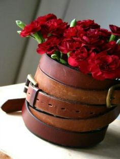 Tin coffe can wrapped in thrift store belts... love the texture!