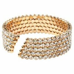 """Understated and sophisticated, this golden brass bracelet showcases rows of sparkling Austrian crystals and adds chic style to any ensemble.    Product: BraceletConstruction Material: Brass and crystalColor: GoldDimensions: 2.25"""" Diameter"""