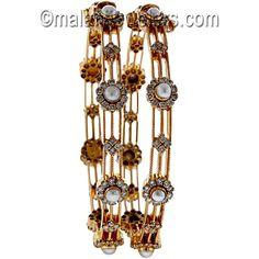 Diamond Pearl Astonishing Bangles 18 Karat Gold. SKU # 463-01031 http://www.malanijewelers.com/diamond-bangles-bracelet.aspx?size=200