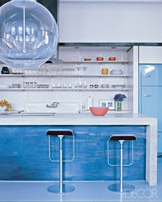 We love the blue kitchen island and retro-style oversized bubble light fixture!