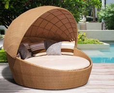 Oyster Wicker Rattan Daybed with Canopy. Lounge in the ultimate luxury and comfort with this beautifully crafted Oyster wicker rattan daybed with canopy. Manufactured from 'soft to touch' synthetic Rehau® this wicker rattan day bed with canopy offers the same look and feel as rattan but offer greater durability and has been built to last ensuring fruitful use for years to come. #rattan #sunlounger #furniture #garden #patio