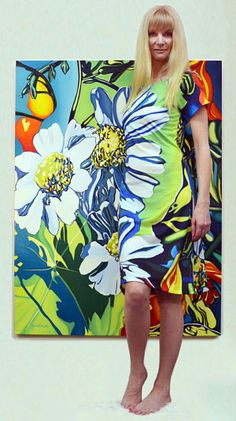 """Artist Anne Gudrun in her """"Daisy"""" dress with original painting"""