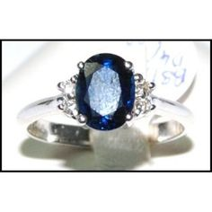 Unique Solitaire Diamond Blue Sapphire Ring 18K White by BKGjewels