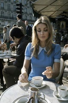 light blue dress at a cafe