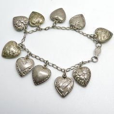 """Vintage Sterling Silver Puffy Heart Sweetheart Charm Bracelet, total of 10 Charms, Art Deco Era Good Vintage Condition, presented unpolished Clasp stamped """"sterling"""" Measurements - end to end; Art Deco Era, Etsy Shop, Vintage, Sterling Silver, Bracelets, Diy, Jewelry, Art Deco, Jewlery"""
