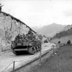 Infantry ride on Sherman tanks of 6th Armoured Division as they head towards the Austrian border, 4 May 1945.