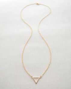 Triangle necklace by Olive Yew on sale. Choose from gold or silver, from $20.80.