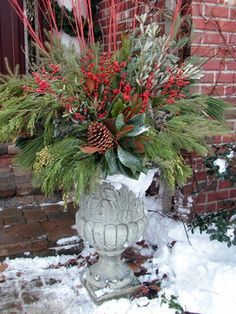 I really doubt I'd like to live in the snow, year after year, but, dangit!... I love this snowy arrangement!  Containers for the Winter Season - traditional - porch - chicago - Smalls Landscaping