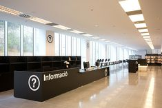 Black and white with a splash of color is always a great way to go when designing an elegant and clear wayfinding system. Barcelona's design studio PFP, Disseny Gràfic used…View Post Info Desk, Reception Counter, Reception Desks, L Office, Sign System, Library Furniture, Counter Design, Bold Typography, Central Library