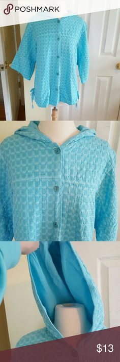 Turquoise blue jacket with 3/4 length sleeves What a great winter pick me up color. This turquoise blue cardigan jacket has pull strings on the side to adjust for your comfort and a hood for cool breezes. A great boutique find. focus Jackets & Coats Utility Jackets