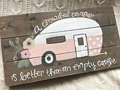 This listing is for a hand painted vintage camper sign which features and pink and white body with polka-dots and vintage flowers. The sign size is approximately 11 tall x 19 wide and is lightly distressed around the edges. A quote surrounds the camper on the top in bottom in white