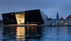 The Black Diamond (Danish: Den Sorte Diamant) is a modern waterfront extension to the Royal Danish Library's old building on Slotsholmen in central Copenhagen, Denmark. Its quasi-official nickname is a reference to its polished black granite cladding and irregular angles. Designed by Danish architects Schmidt Hammer Lassen, the Black Diamond was completed in 1999 as the first in a series of large-scale cultural buildings along Copenhagen's waterfront.