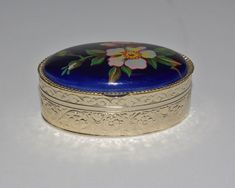 Oval Metal Trinket Box with Flowers on by StetsonCollectibles