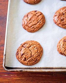 Huge, craggy, chewy, and delicious, these cookies are guaranteed to become classics in your kitchen. The whole-wheat flour gives them a rich nuttiness; the heft, caramel glow, and generous chunks of hand-chopped chocolate make them irresistible.