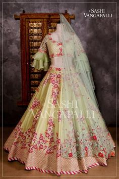 Stunning pista green color lehenga and blouse with net dupatta. Lehenga and blouse with floral design hand embroidery pink thread work. They make sure there s something about each dress that ignites the brides imagination ! Indian Fashion Dresses, Indian Bridal Outfits, Indian Bridal Lehenga, Indian Gowns Dresses, Dress Indian Style, Indian Designer Outfits, Eid Dresses, Bridal Dresses, Designer Party Wear Dresses