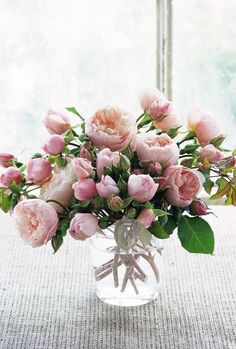 Perfectly pink! This arrangement incorporates both buds and blooms of 'The Generous Gardener' (AUSdrawn). Photo courtesy of David Austin Roses. #roses