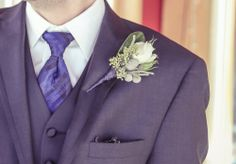 Rose, silver brunia and seeded eucalyptus boutonniere wrapped with blue wire. Flowers by Dandie Andie Floral Designs Photo by New Vintage Media