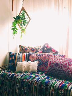 get the boho nook look -- Boho interior, colorful mandala throw pillows -- eclectic bohemian woven native american design