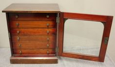"""Antique collectors cabinet with six fitted drawers with removable glass tops. From a Central Park South NYC estate. Dimensions: Cabinet - 15"""" w x 10"""" d x 17"""" h , caddy - 9.75"""" w x 4.75"""" d x 5"""" h."""