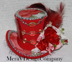SOLD---Red Mini Top Hat Steampunk Sexy Beaded Corset Roses Pattern Silver Spring Feathers---SOLD---. $35.00, via Etsy.