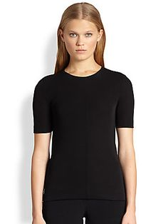 """T by Alexander Wang Draped Cutout-Back Tee $245 A draped cutout at the back of this sleek tee lends the minimalist style a hint of drama.  Short sleeves Center seam detail Draped cutout at back Pullover style About 24"""" from shoulder to hem Viscose Dry clean Imported"""