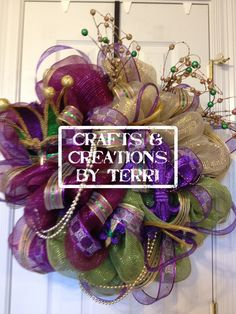 Mardi Gras deco mesh wreath. These can be done in any color and/or any holiday.  Please visit www.Etsy.com/shop/CreatedByTerri  or www.facebook.com/CraftsandCreationsByTerri for updates and contest giveaways!!!