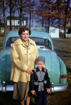 Midcentury Mom: 1952. The coat is rather frumpy (maybe she's preggo) but I like her hair!