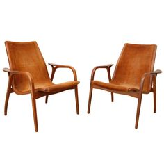 Pair of Lamino Low Back Lounge Chairs by Yngve Ekstrom | From a unique collection of antique and modern lounge chairs at https://www.1stdibs.com/furniture/seating/lounge-chairs/