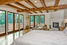 Beamed Bedroom - Miley Cyrus's Tuscan-Style Mansion in  Los Angeles - Photos