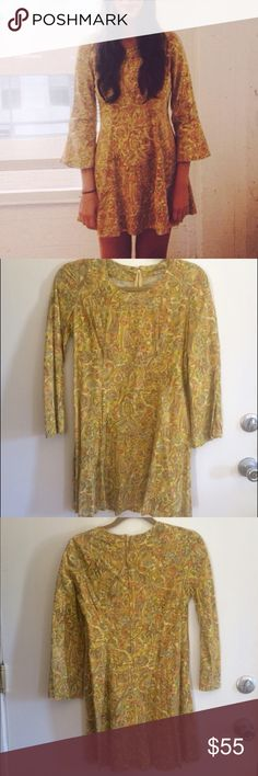 Vintage bell sleeve dress Vintage bell sleeve mini dress with golden paisley floral print. Zip up back. In good condition. Vintage Dresses Mini